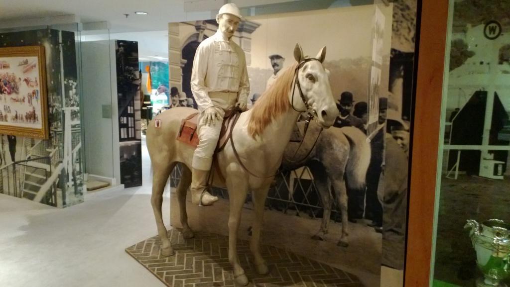 white wax figure jockey pony