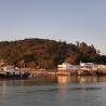 fishing boats stilt houses sea mountain trees
