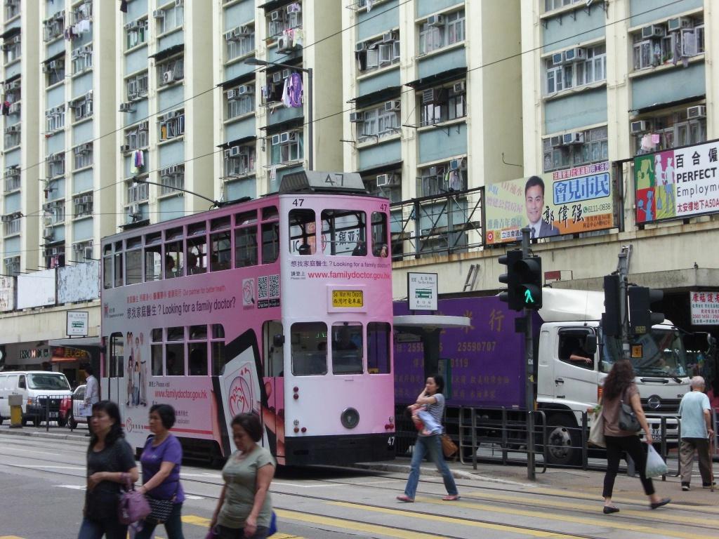 tram people buildings lorry traffic lights