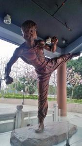 Bruce Lee kicking statue Hong Kong Heritage Museum