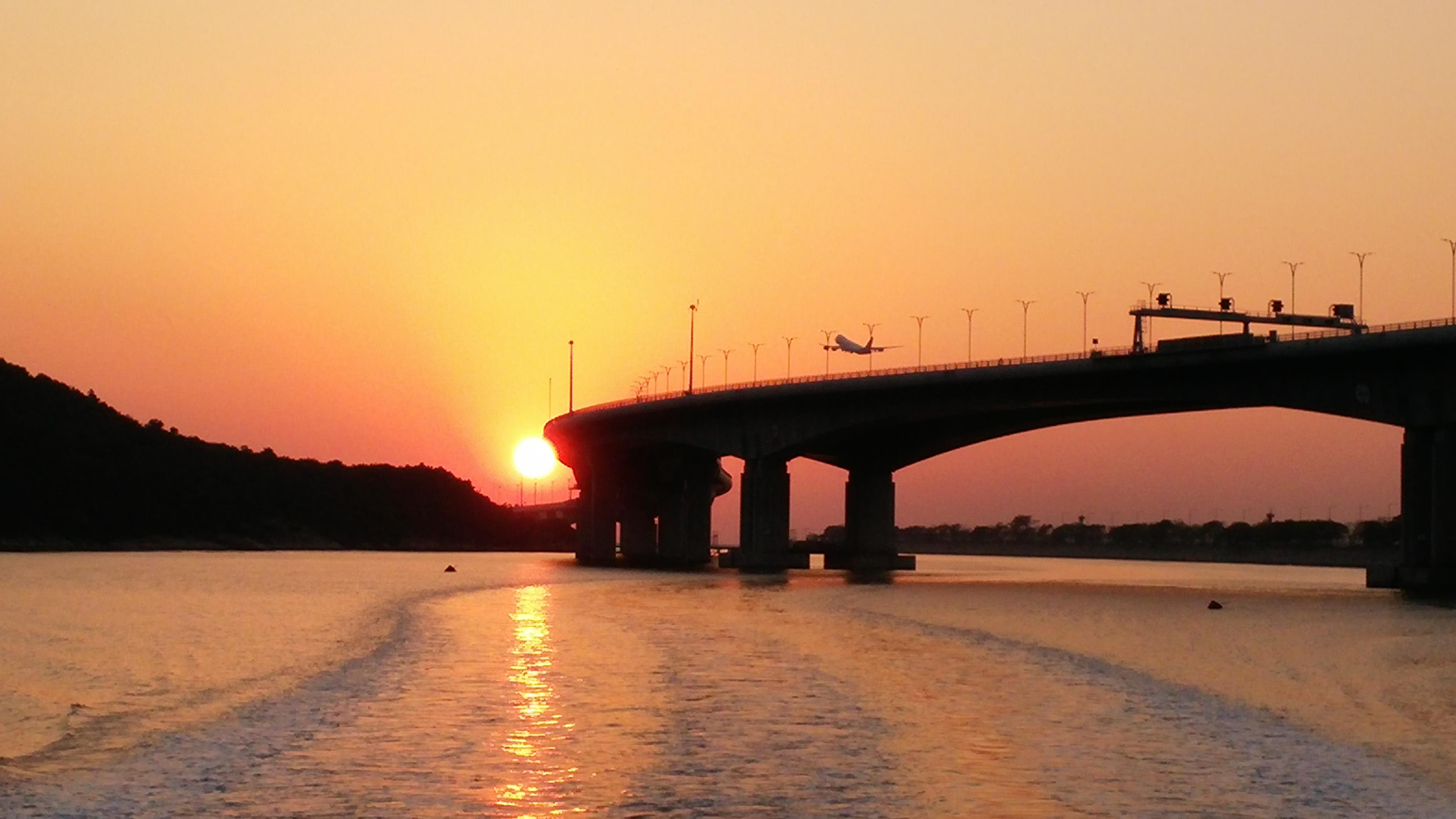 See Hong Kong Macau Zhuhai Bridge, sunset and flight takes off during Tai O to Tung Chung Ferry ride