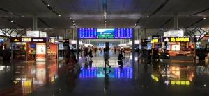 train station, passengers, screen shops