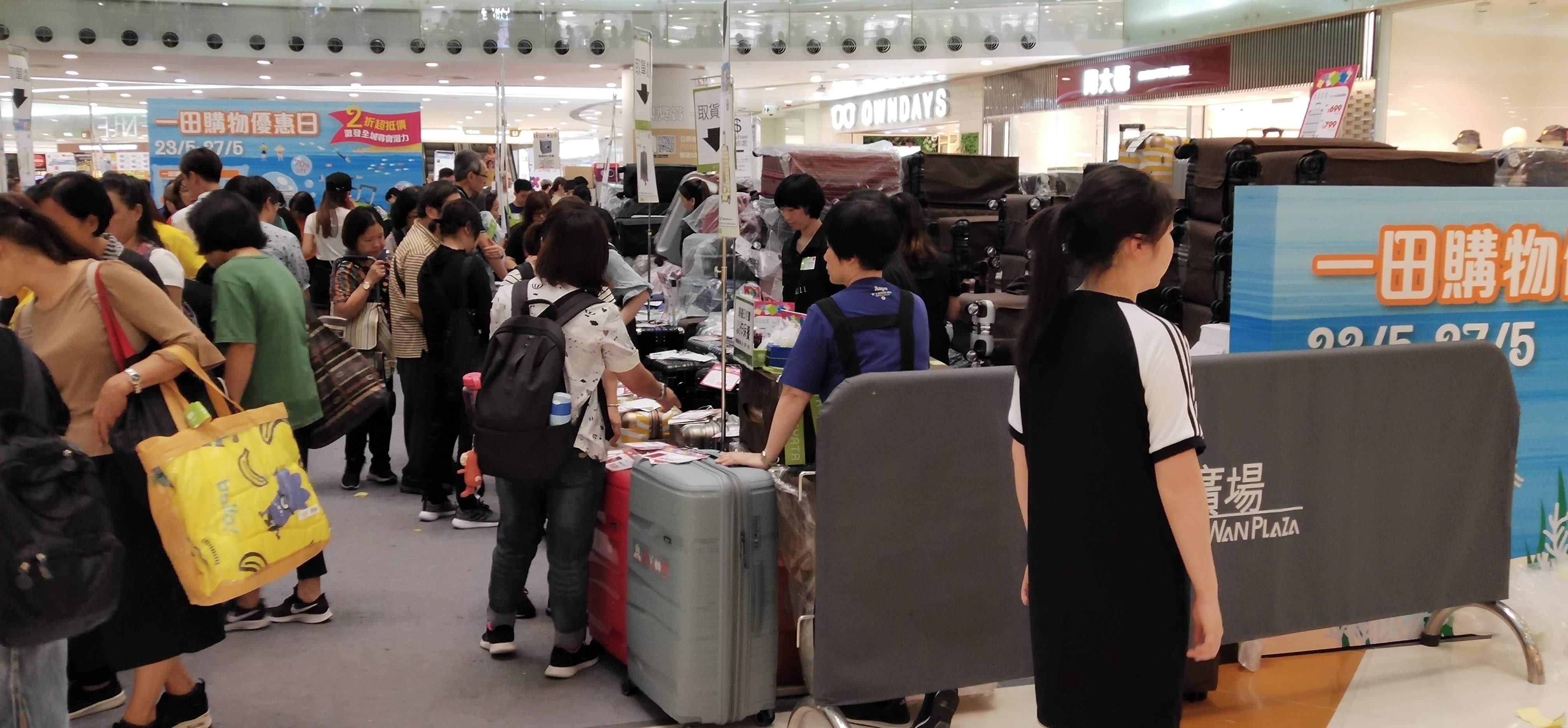 Crowds buying suitcase