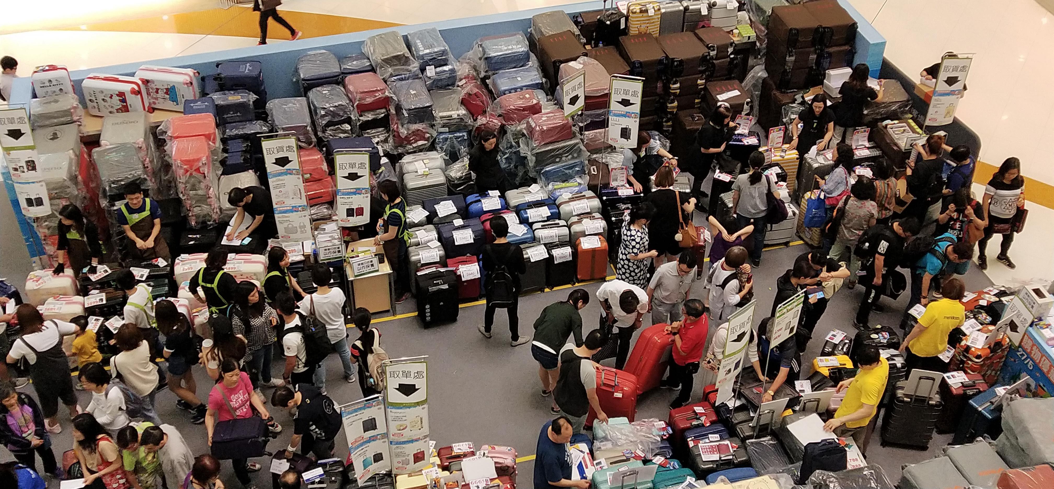shopper buying suitcase, shopkeepers selling suitcase