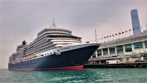 Queen Elizabeth, berthing at Ocean Terminal.