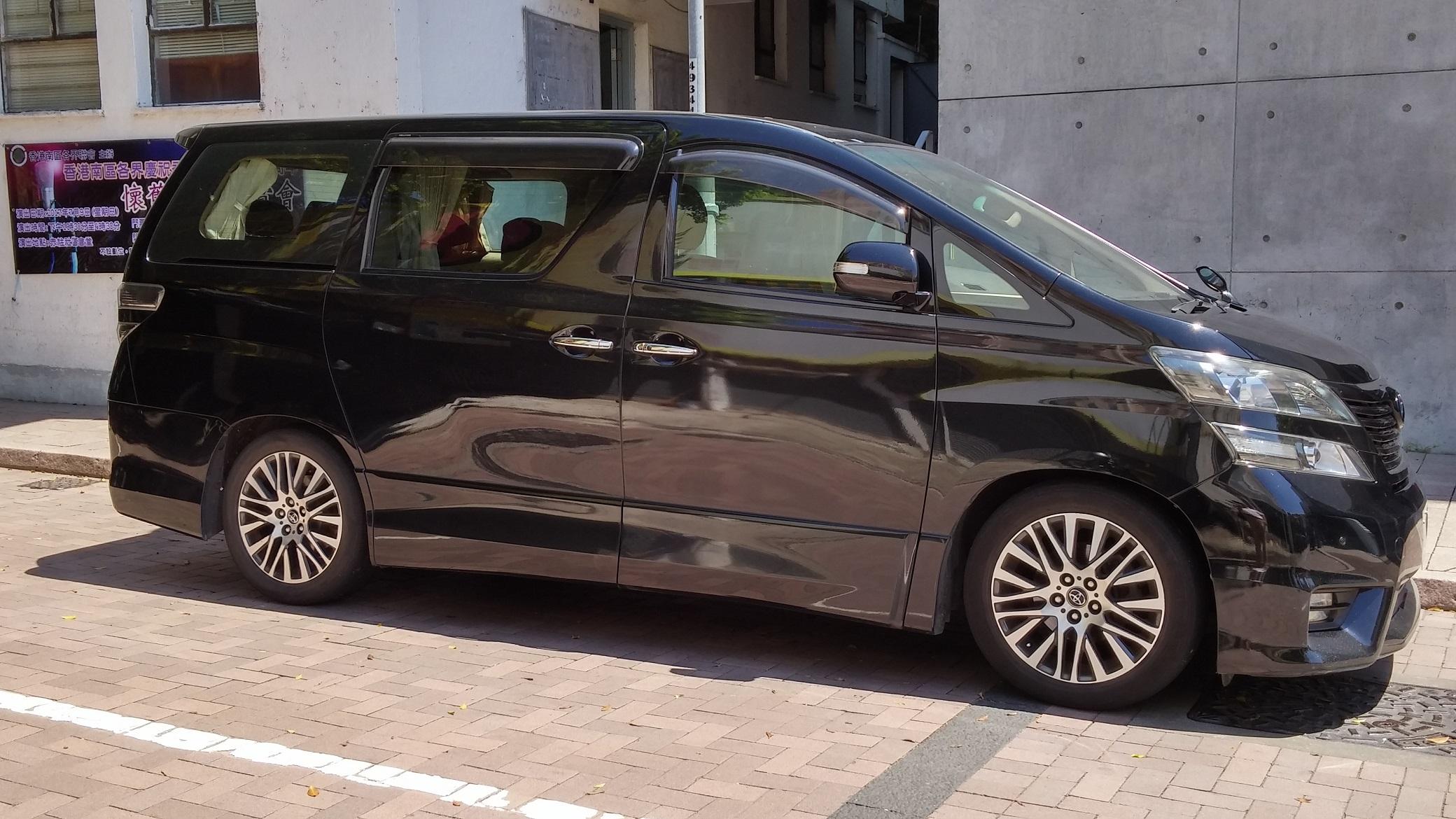 Black Toyota brand mini van