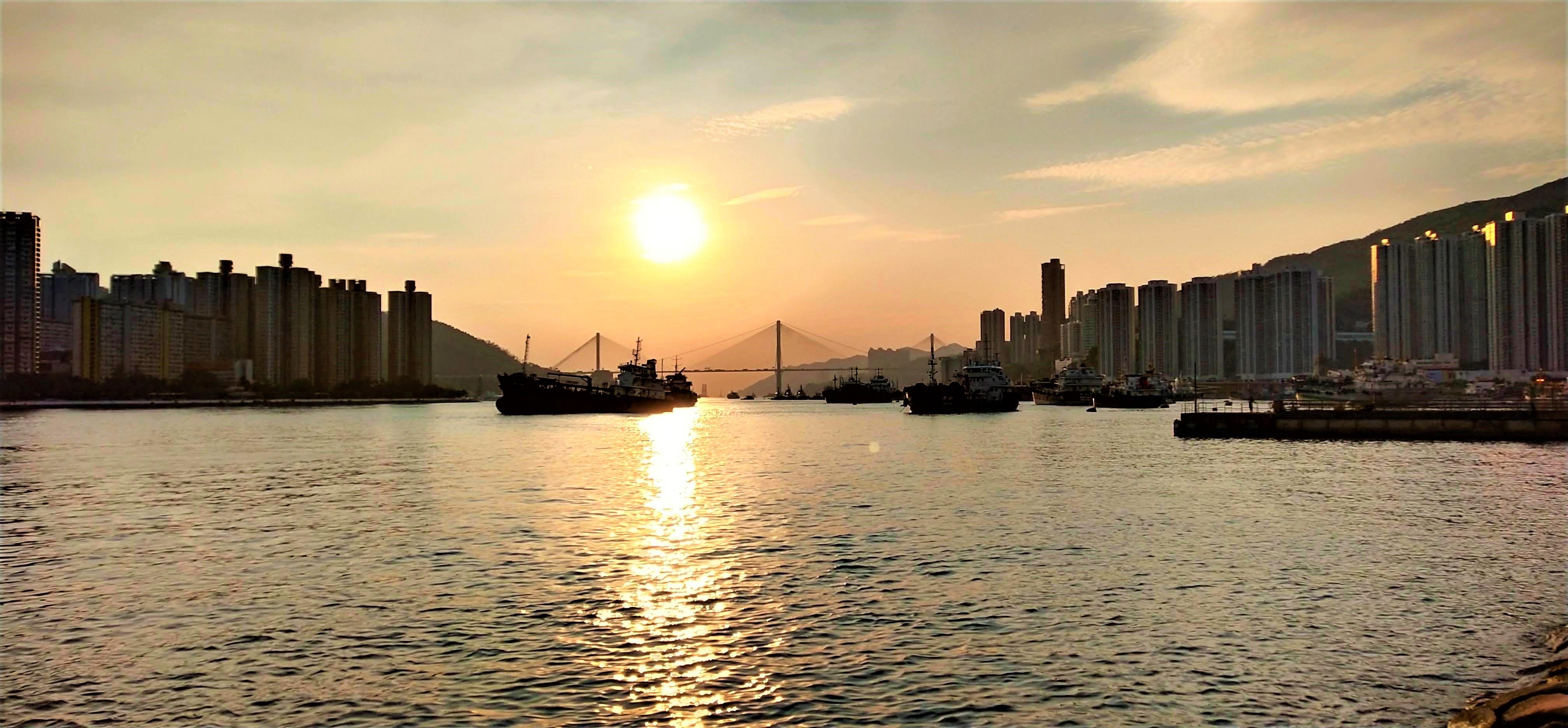 See sunset at promenade next to Tseun Wan West Station