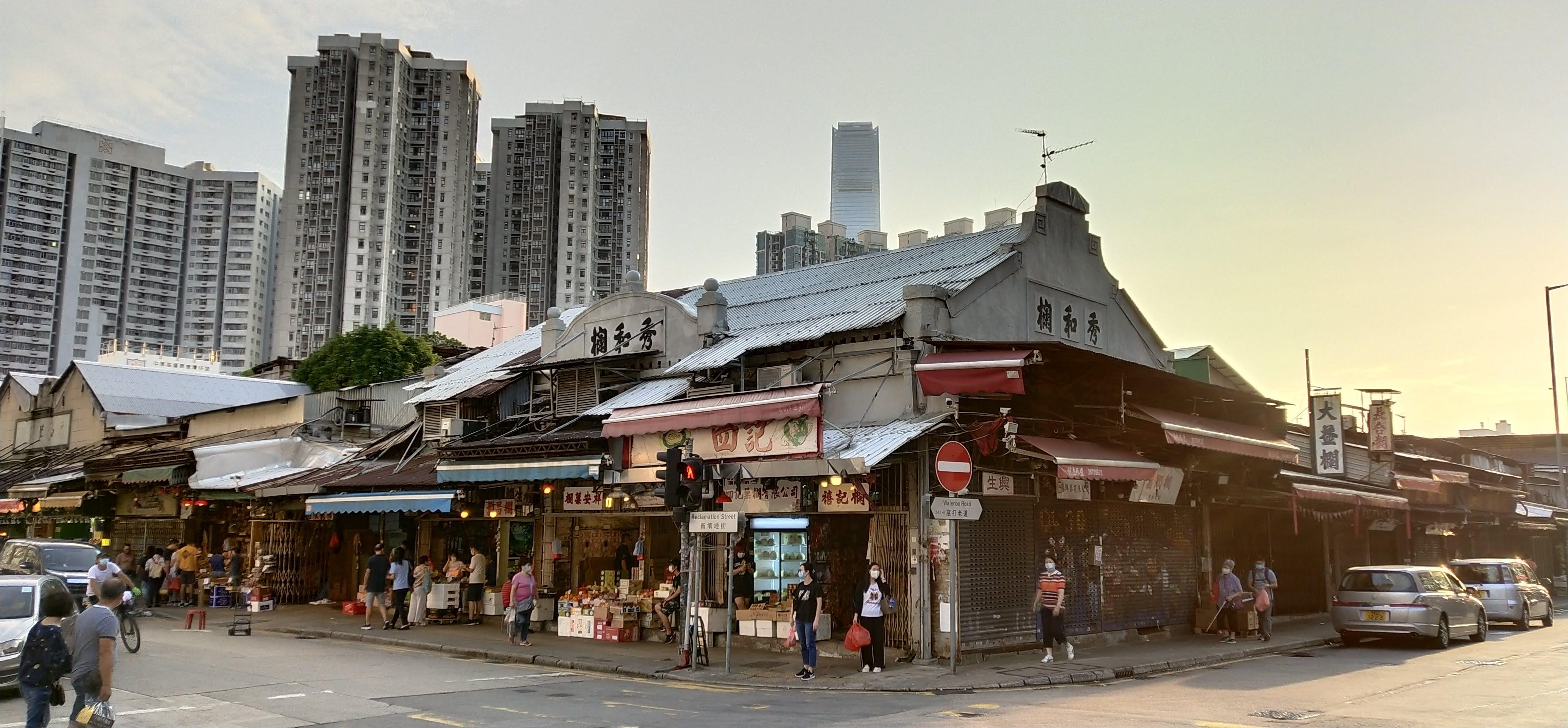 Yau Ma Tei Wholesale Fruit Market, the backdrop is the tallest ICC building