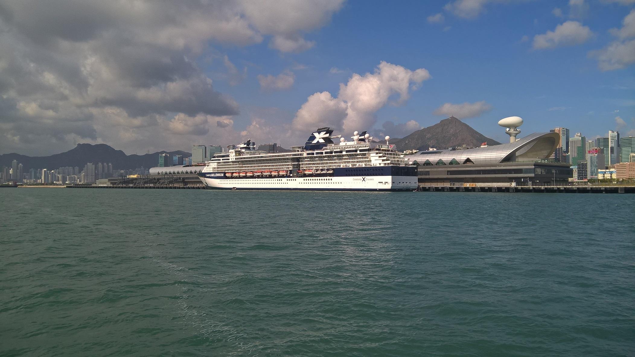 Photo taken from local ferry. Left to right, Lion Rock, Kai Tak Cruise Terminal, Kowloon Peak
